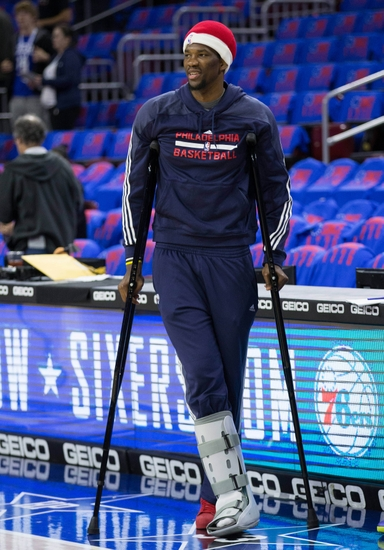 Injured philadelphia 76ers center joel embiid leans on his crutches